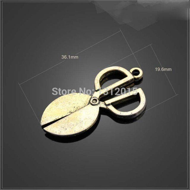 Free shipping wholesale charms pendants alloy metal antique bronze free shipping wholesale charms pendants alloy metal antique bronze 361x196mm scissor pigeon aloadofball Images