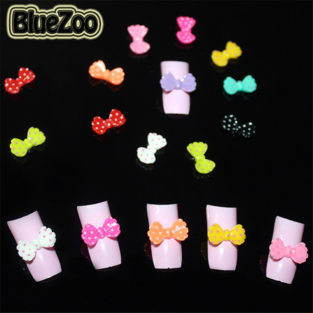 BlueZoo 100pcs Mixed Colors Acrylic Nail Decoration Cute 3D Bow Tie Nail Art Studs Tips For Diy Nail Decoration Beauty Design