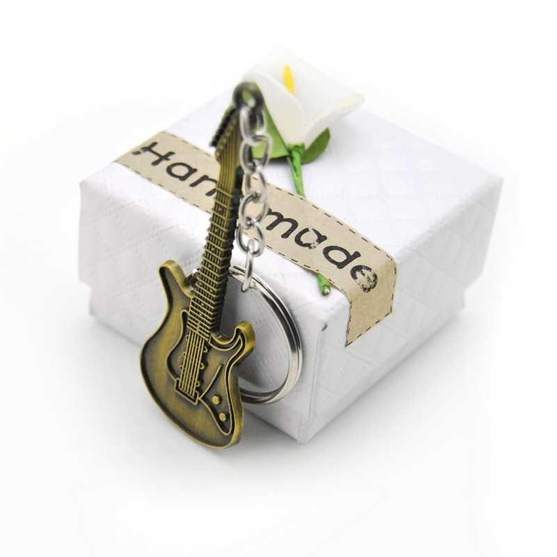 Оригинальный Новый Модный уникальный брелок-гитара кошелек сумка Подвески-сумочки Подвеска для Автомобильный Брелок женское кольцо для ключей с подвеской вечерние подарки