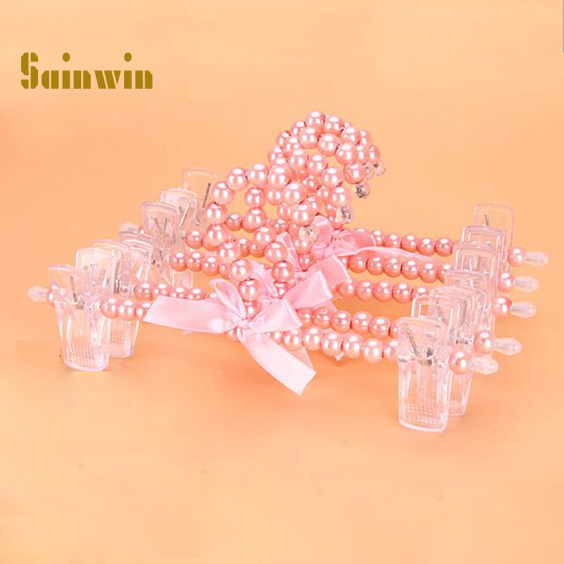 Sainwin 10pcs / lot 25cm Tocătoare pentru copii pentru copii Pearl pentru bebeluși din plastic Pantaloni Clipuri pentru agățat Rack pentru îmbrăcăminte