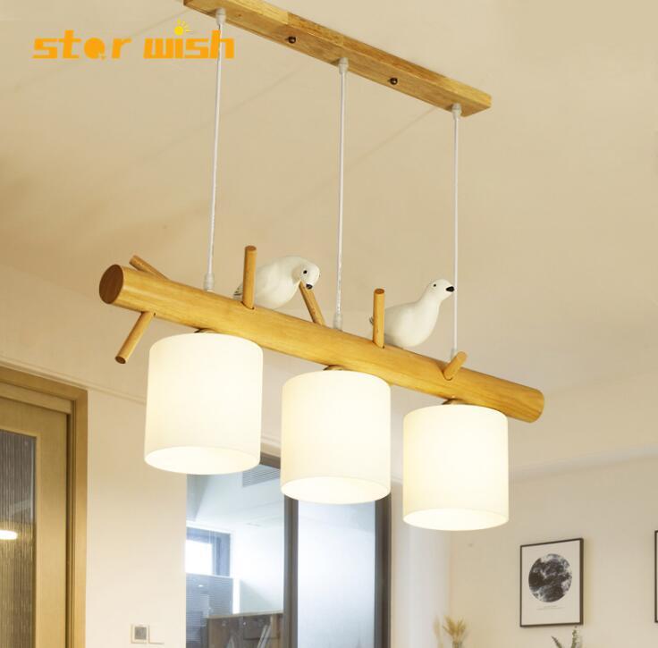 Nordique créatif style pastoral personnalité lustre simple moderne oiseau trois-tête restaurant bar table à manger suspendus bois lam