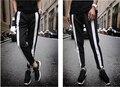 Europa y américa golpeó el color negro y rayas blancas colores mezclados ocasionales salvajes pantalones de guardia traje pantalones hombres más el tamaño