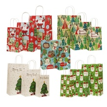 цена 50pcs/lot Paper Bags 27*21*11cm Merry Christmas Santa Claus Elk Pattern Cookies Gift Packing Bag Supplies For Christmas Party в интернет-магазинах