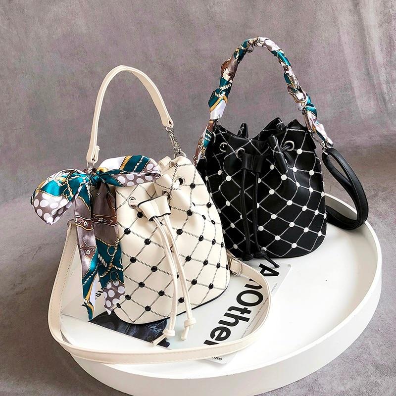 2019 high quality rivet crossbody bag female Messenger bag handbag luxury brand ladies bucket bag fashion tassel shoulder bag in Top Handle Bags from Luggage Bags