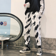 Fashion Casual Mens Harem Pants Spring And Autumn New M-2XL Contrast Color Loose Black White Personality Youth Popular
