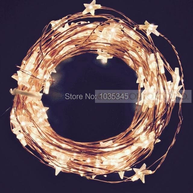 best sneakers ac914 df1ff 10M 100LED Star Copper Wire String Lights LED Fairy Christmas Lights  Wedding decoration Lights Plug In Adapter Included