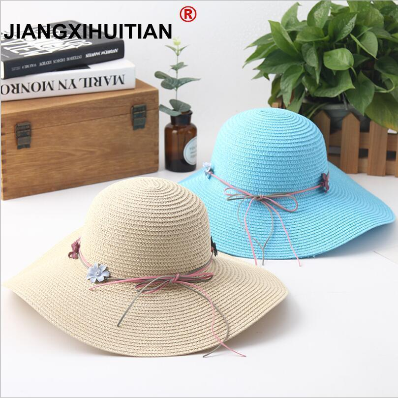 1a9a91e0 2018 new Flower beads bow decoration cap Big brim Ladies summer straw hat  youth hats for women Shade sun hats Beach hat sale