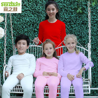 New winter warm Children pajamas suit with Solid color the boys and girls pyjamas plush thermal comfort suit Long top and pants