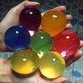 50 unids/lote 10-12mm Grande de Cristal Perlas de Agua Del Suelo de Barro de Hidrogel Gel Niños Juguete Crecer Orbiz Agua bolas de Decoración del Hogar de La Boda
