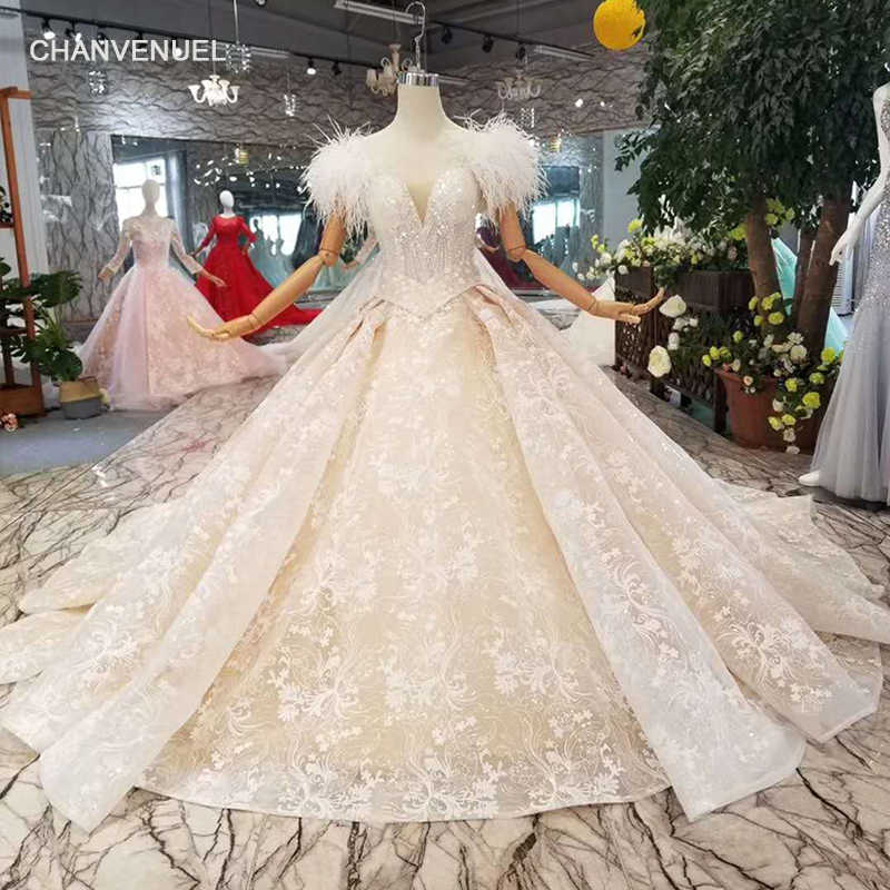 aceeec9cd0f0e LS11006 Ostrich feather wedding dresses with belt 2019 new design appliques  shiny lace wedding gowns with
