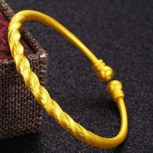 Крученый браслет из желтого золота женский цельное ювелирное