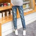 2016 Venta CALIENTE nueva personalidad agujero pantalones vaqueros de maternidad, moda mujeres embarazadas sueltos cuidado del vientre pantalones rectos de ropa de mujer
