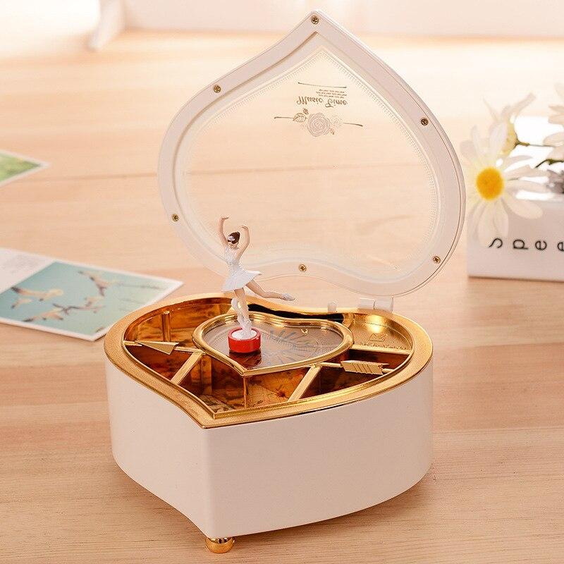 Caja de música de bailarina bailando con forma de corazón caja de joyería de plástico para niñas carrusel manivela manual caja de música mecanismo de regalo