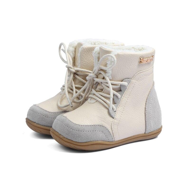 Bambino in vera pelle stivali da neve femminile antiscivolo bambino stivali  maschili stivali medio piedino del bambino di cotone imbottito scarpe suola  ... fa580f8f209