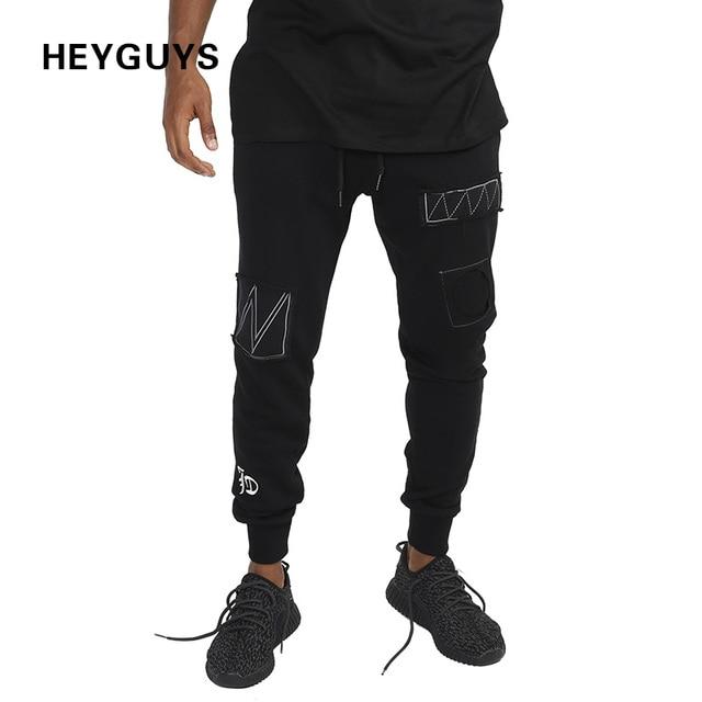 HEYGUYS 2017 moda Pantalones de fitness hombres pantalones cargo pantalones  de chándal pantalones ajustados de moda e656a15f9f3
