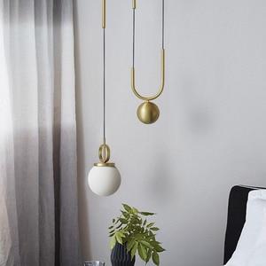 Image 2 - American Post modern Electroplating bronze Stretchable Glass pellet Chandelier Bedroom machine head Living room Coffee shop