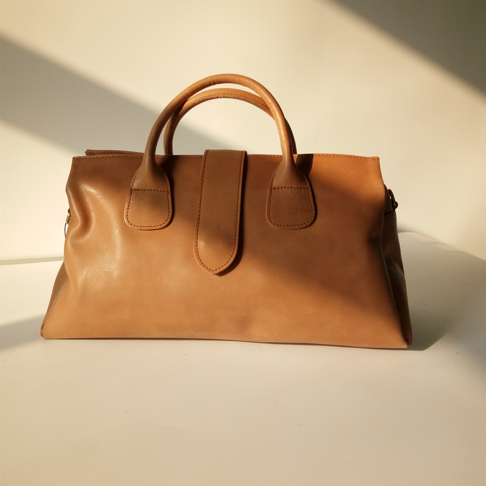 все цены на 2018 trendy novelty big genuine leather tote handbag for women large capacity cow leather one shoulder bag traveling luggage bag онлайн