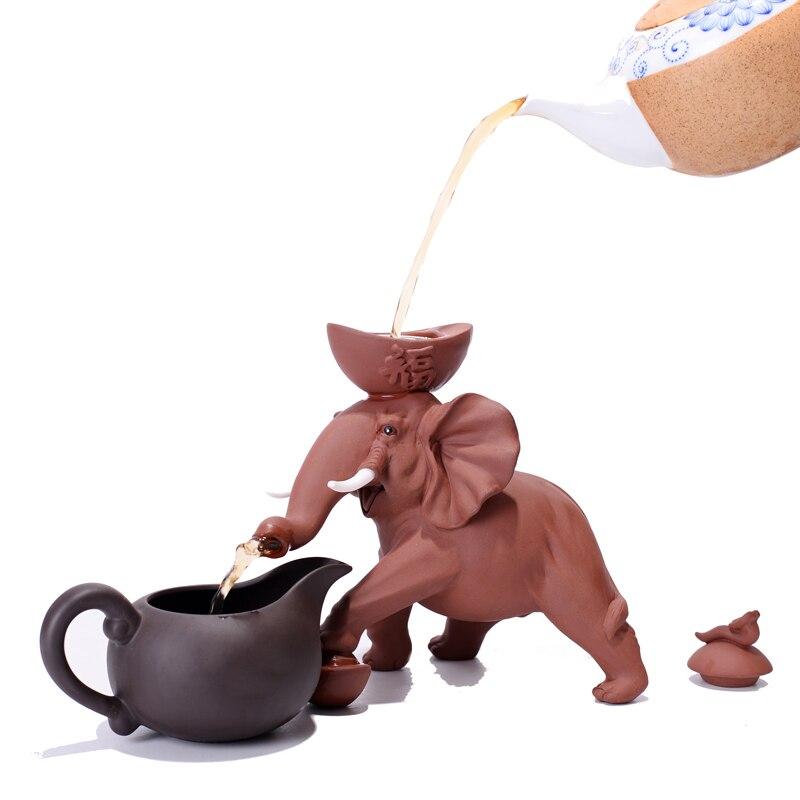 Eléphant thé filtre Zisha théière passoire thé Pet thé fuite avec juste tasses ensemble créatif éléphant thé jeu livraison gratuite