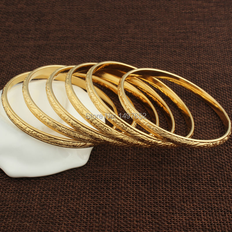 vuitton bangle bracelet large us a metal louis gimme brass gold clue en bracelets tone plated bangles