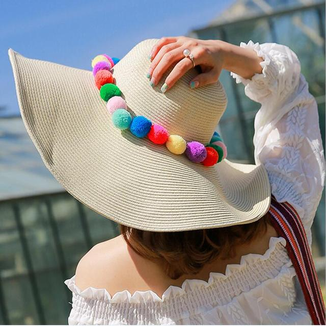 9d6360a25 US $9.84 7% OFF| Summer Women's Foldable Beach Sun hat Wide brim Hat Pom  Pom Straw Outdoor Cap 4 colors -in Sun Hats from Apparel Accessories on ...