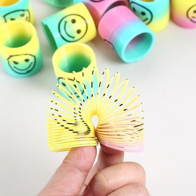 Novita Giochi A Molla Sorridente Pioggia Arco Slinky Bobina Di