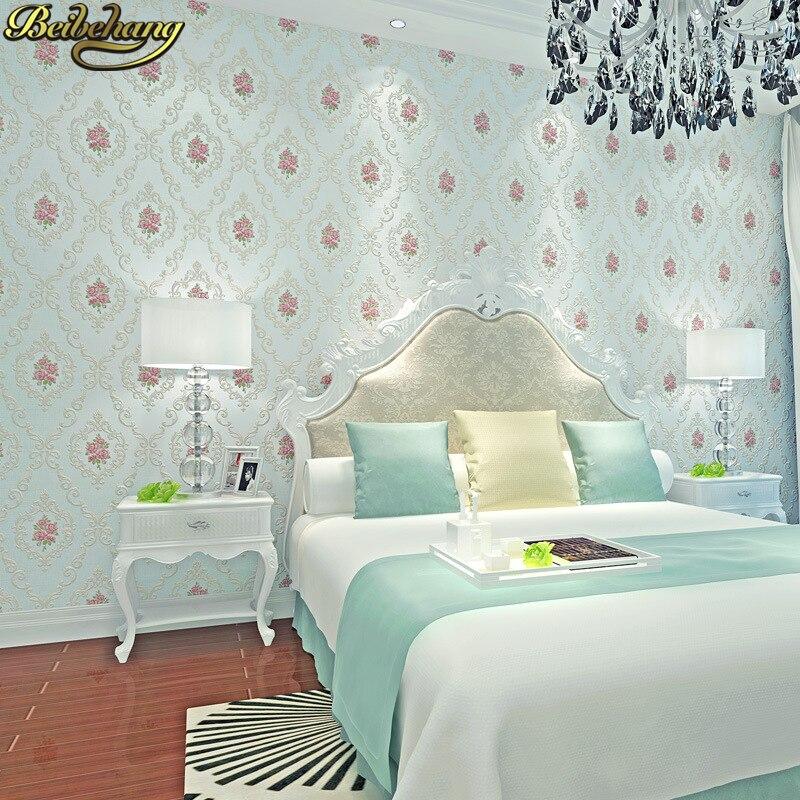 Купить с кэшбэком beibehang Floral Wallpapers for living room Wall Covering Flower TV Bed Room Embossed Textured Wallpaper roll papel de parede 3D
