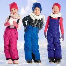 2016 Niños Del Invierno de Esquí Snowboard Pantalones Tirantes Baberos para Esqui Esquí Pantalones Pantalones Para la Nieve Caliente Niños Niñas Impermeable Al Aire Libre