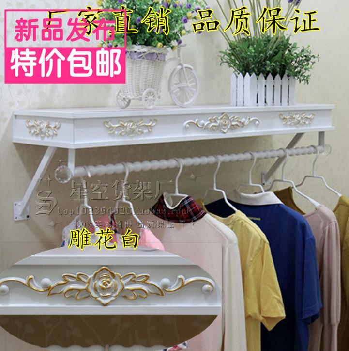 Clothes hangers show. On the wall clothing. Clothing store shelves of carve patterns or designs on woodwork hanging.