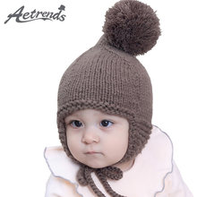 221f6048a17  AETRENDS  6-24 Bulan Bayi Lucu Pom Pom Beanie Topi Bayi Beanies Indah  dengan Top Bola Z-6190
