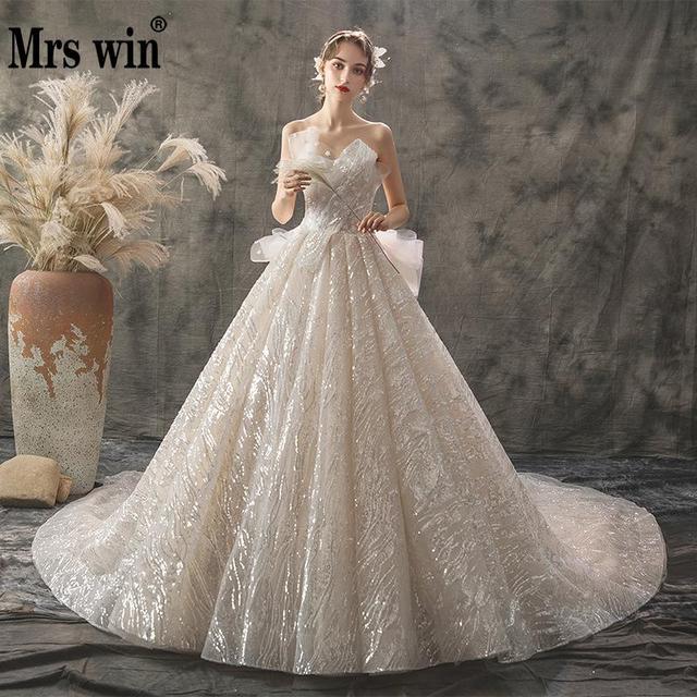 2020 新夫人勝利ウェディングドレスセクシーなストラップレスの夜会服の高級ケバケバビーズ王女 Vestido デ Noiva ローブ · デのみ