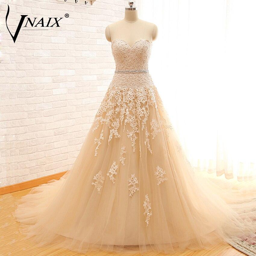 Vnaix W1103 Stövlarna Lace Appliques En Line Bröllopsklänningar Brudklänning Kappa Märken