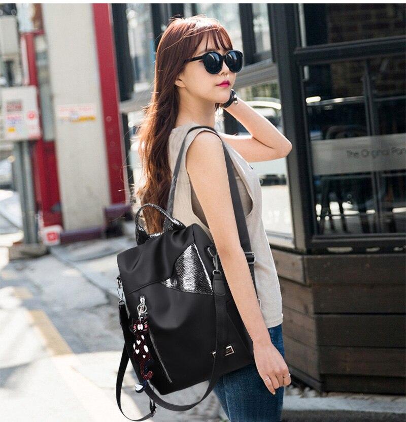 HTB1 imaMhYaK1RjSZFnq6y80pXam Simple style ladies backpack anti-theft Oxford cloth tarpaulin stitching sequins juvenile college bag purse Bagpack Mochila