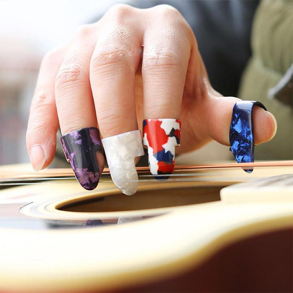 3 finger picks and 1 thumb pick 7