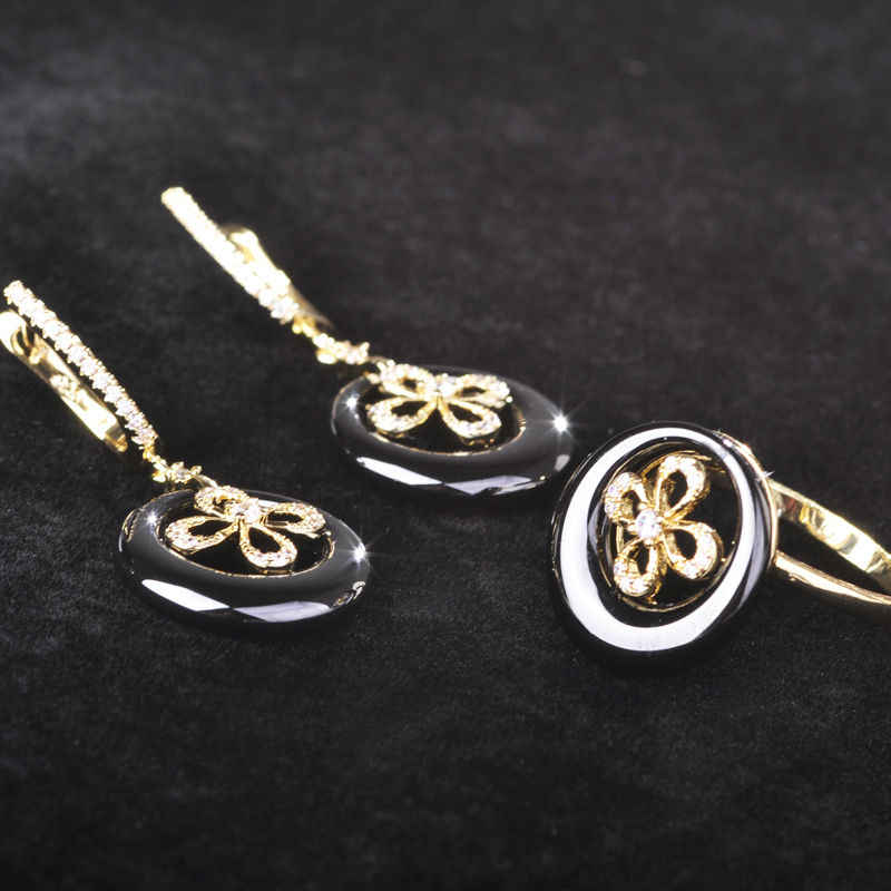 Blucome Zircon Rose Gold สีเซรามิคสีขาวชุดเครื่องประดับ Hollow Out ต่างหูดอกไม้ชุดแหวนสำหรับผู้หญิงงานแต่งงานทองแดงเครื่องประดับ