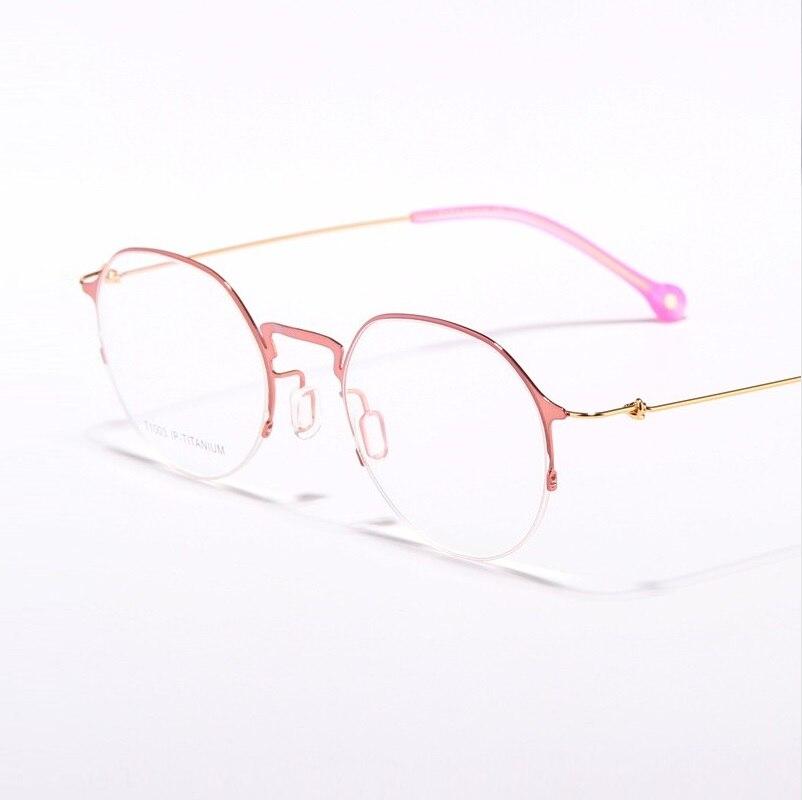 49-22-140 новая личность тонкие ноги нет винт близорукость круглые кадр очки мужчин и женщин пары Pure Titanium очки 1003
