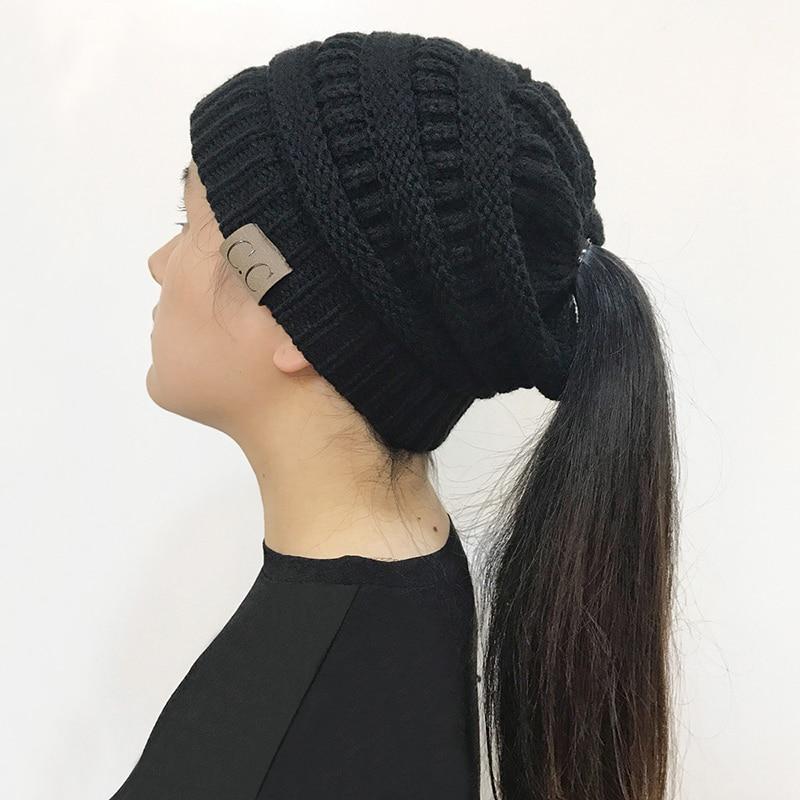 6c80cb5cbd9 2018 New Trendy CC Warm Winter Hat For Women Ponytail Beanie Stretch Cable  Knit Messy Bun ...