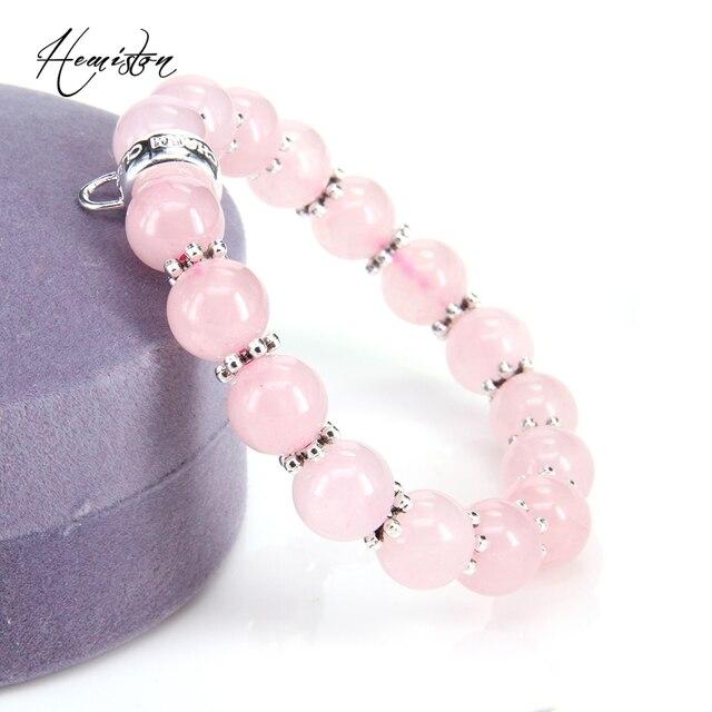 Фото розовый кварцевый кристалл thomas 10 мм браслет из бисера снежинки цена