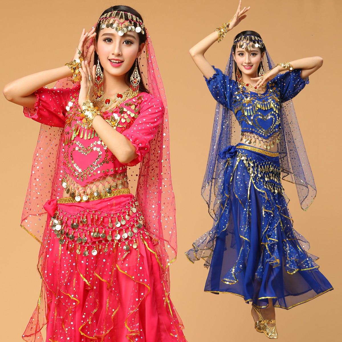 colorful hindu dancers in big costumes