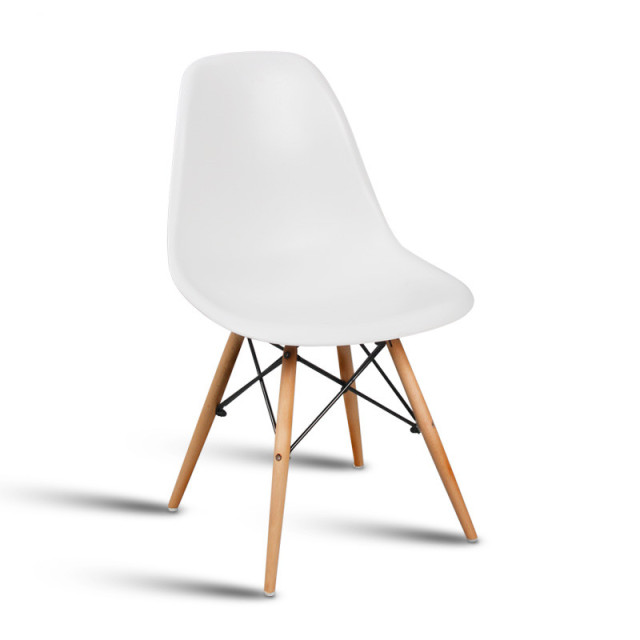 XiaoSen furniture.The modern popular plastic chair. Leisure dining chair. Composition of synthetic resin and solid wood legs.