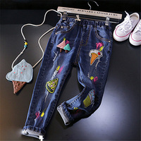 2017 Primavera Estate Bambini Abbigliamento Ragazze Fashion Graffiti Dei Jeans Del Fumetto Immagine foro Strappato I Pantaloni Per Bambini 2 3 4 5 6 7 anni