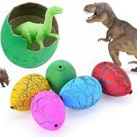 2017 חדש 60 יחידות נהר מים אבנים קסם גידול דינוזאורים בקיעת ביצי ילדי צעצוע מתנה חמודה בנים מקסימים משלוח חינם