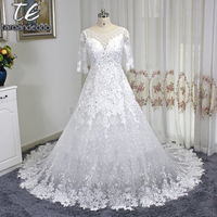 Sheer Scoop Neck Half Sleeves Dotted Lace High Quality Lace Wedding Dress With Crystals Long Train