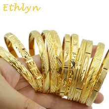 Ethlyn mody Dubai złota biżuteria złoty kolor bransoletki dla etiopii bransoletki i bransolety etiopski biżuteria bransoletki prezent tanie tanio Miedzi Kobiety TRENDY Brak Okrągły Złoto-kolor Metal Moda 65mm