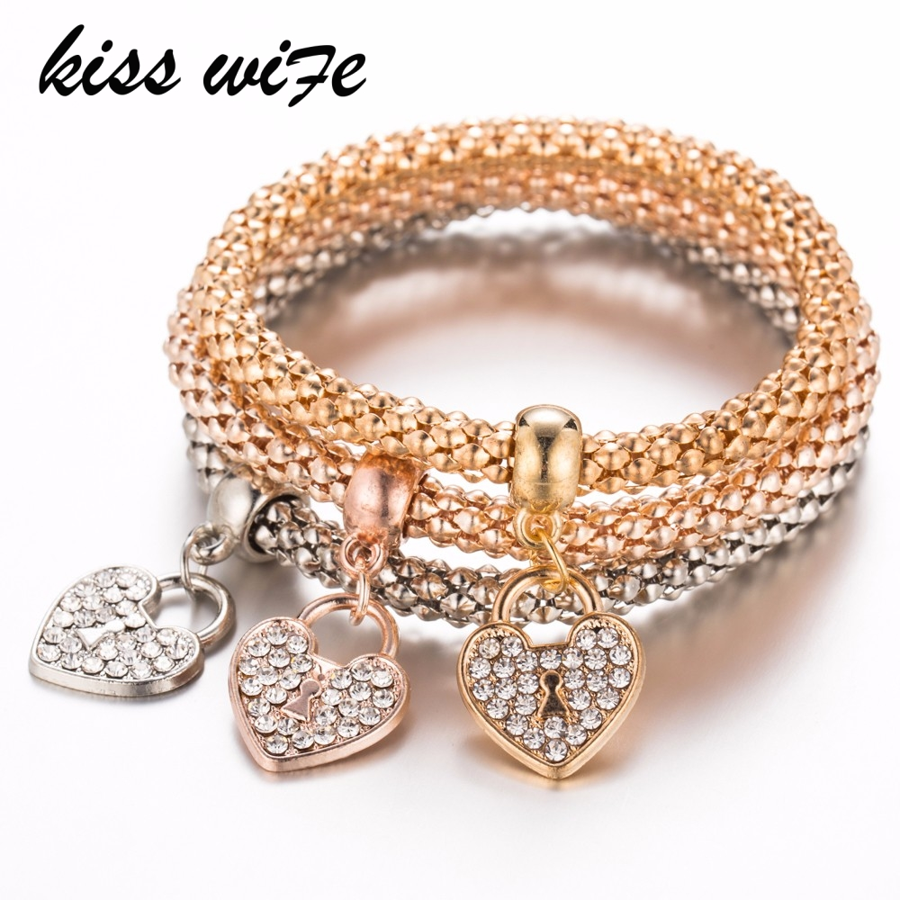 2ac32beacdae Beso esposa 3 unids pulseras unisex moda oro plata Rosa oro metal elástico  rhinestones corazón colgante amor pulsera casual Chai