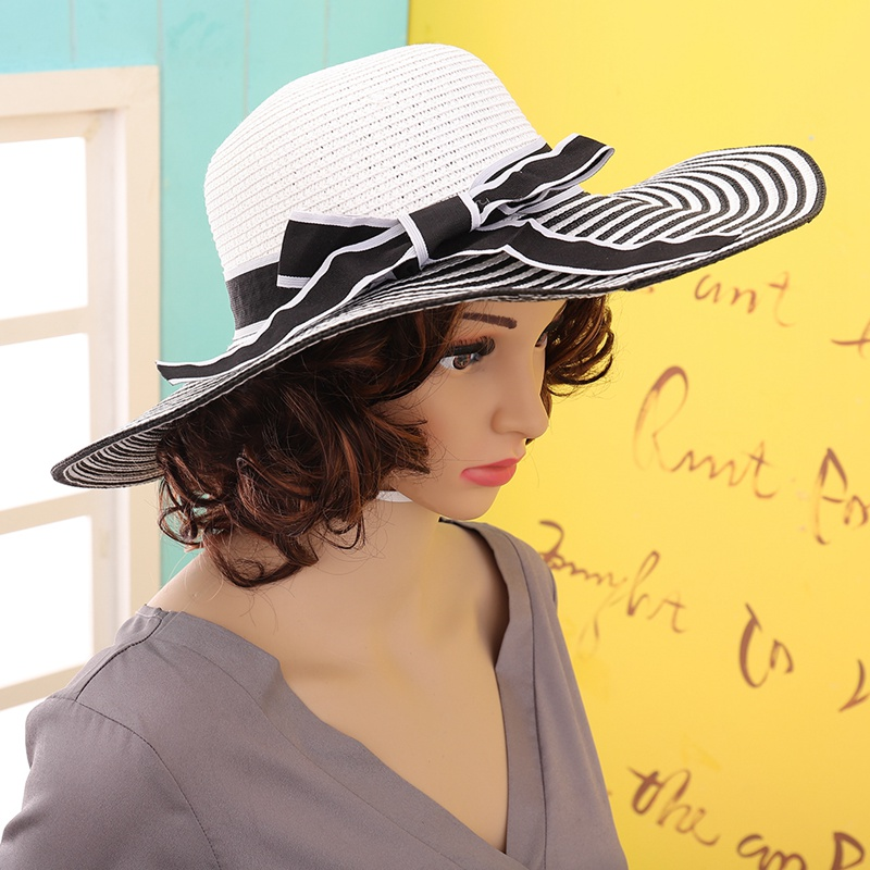 5386042e8 Hot Sale Fashion Large Brimmed Hat Hepburn Wind Black White Striped Bowknot  Summer Sun Hat Beautiful Women Straw Beach Hat