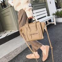 New fashion leather handbag smiley wild Shoulder Bag slung wings bat bag Large size .