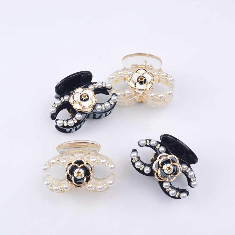 韓国のヘアアクセサリー真珠キャッチクリップ椿真珠髪飾り人気の花の女性のヘアアクセサリー