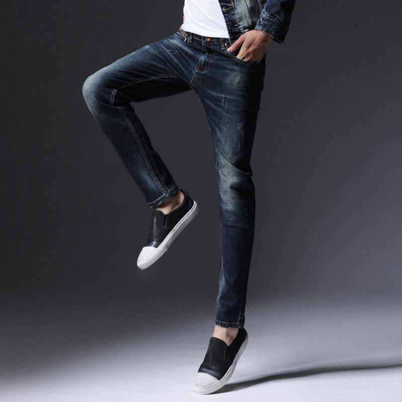 The new youth frayed jeans male Slim feet men 's jeans autumn and winter new men' s trousers stretch denim pants