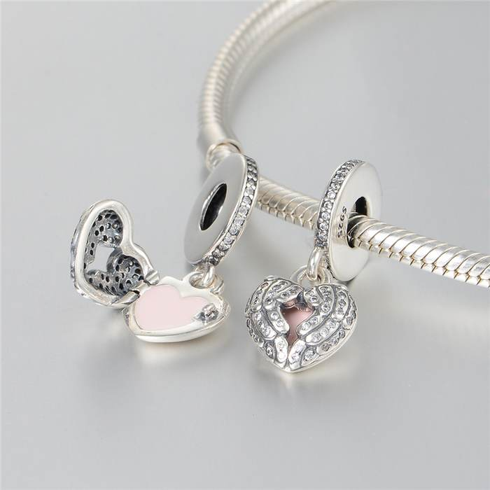 6c6a1b346 pandora angel wings with pink enamel and clear cz dangle