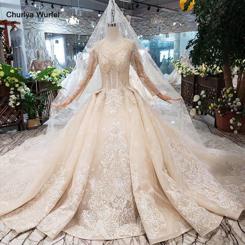 Femmes de luxe robes de mariée avec cristal et manches princesse robes de mariée avec voile anniversaire discount Suknia slubna HTL270